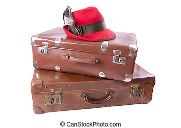Two vintage suitcases with tradition Bavarian hat