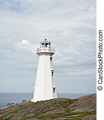 The modern lighthouse at Cape Spear in the rocks on the...