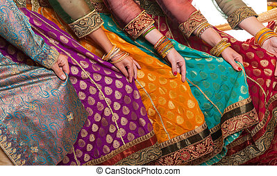 Bollywood dancers dress - Bollywood dancers are holding...