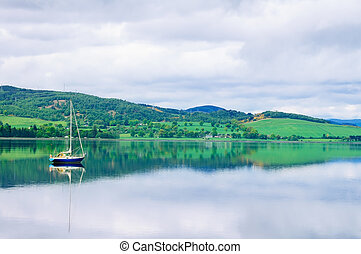 Sailing Boat in Moray Firth near Loch and River ness....