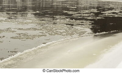floe river bank ice snow - closeup of floe float flow on...