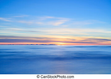 Corsica or Corse island sunset view from Italian beach...
