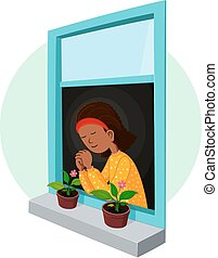 african girl praying in the window suitable for...