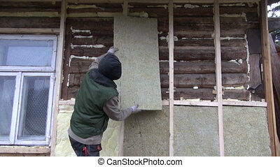 old wooden house thermal insulation with rockwool works