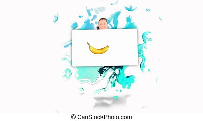 Smiling woman holding a poster of fruits falling into water...