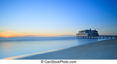 Pier and building on sea and beach Follonica, Tuscany Italy...