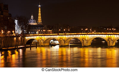 Pont Neuf in Paris at night - view of French Academy through...