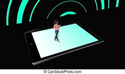 Girl walking on and using tablet pc with holographic...