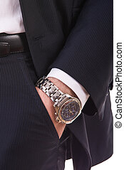 Businessmans hand in the pocket with wristwatch