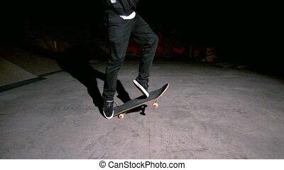 Skater doing 360 flip trick in slow motion