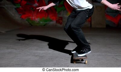 Front view of skater doing 360 flip in slow motion
