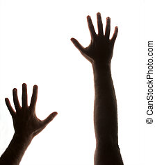 reaching out - partially silhouetted hands backlit and on...
