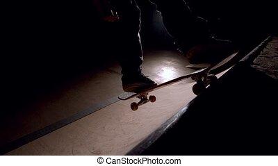 Skater dropping in on ramp - Skater dropping in on ramp in...