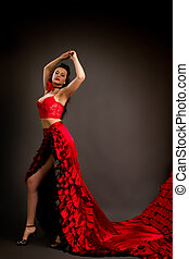 photo of the lady in gypsy costume dancing flamenco