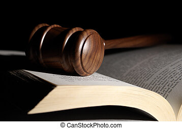 Low Key Legal System - A low key shot of a gavel on a book