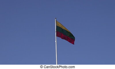lithuanian national flag in wind on sky background