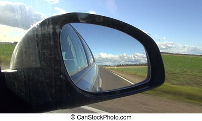 car driving through the empty road and  mirror
