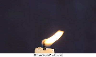 candle flame on dark background - candle flame on dark night...