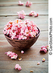 Chocolate popcorn - Pink chocolate pop corn in brown bowl