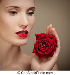 Beautiful Woman Holding Red Rose In Hand