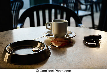 Drunk coffee - An empty cup of coffee is on the table in the...