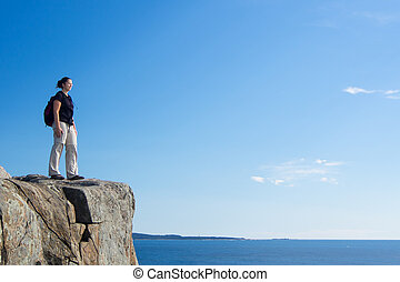 Hiking in Acadia National Park - Woman hiking in Acadia...