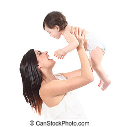 Attractive mother laughing and raising her daughter isolated...