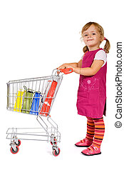 Little girl shopping - Little girl with shopping with a cart...