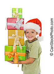 Happy boy at christmas with lots of presents