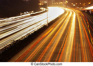 city - moving car with blur light through city at night