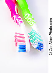Two toothbrushes - Two colorful toothbrushes on white...
