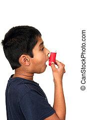 Inhaler - An allergic kid taking medicine thru inhaler