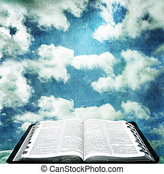 Open Bible with Grunge Sky - Open Bible over cloudy sky with...