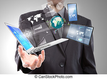 Businessman with laptop,mobile phone,touch screen device -...