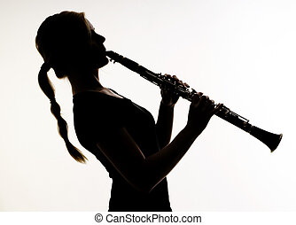 Female Musician Practices her Woodwind Technique on a...