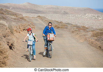 Girl with her mother on bikes