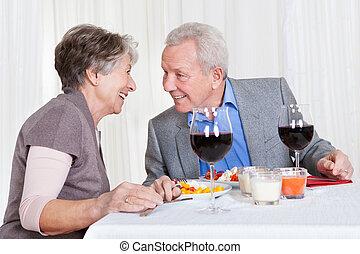 Senior Couple Enjoying Dinner Together - Portrait Of Senior...