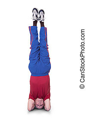 Senior Man Performing Yoga Headstand On White Background