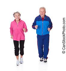 Portrait Of Senior Couple Jogging