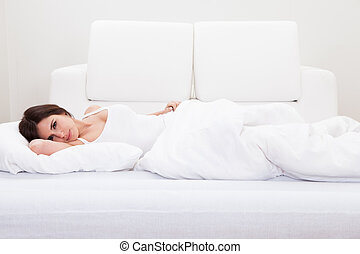 Young Woman Sleeping On The Bed - Portrait Of The Beautiful...