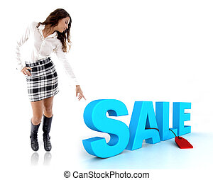 woman pointing at three dimensional sale text
