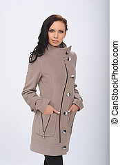 girl in overcoat - Photo beautiful girl on the set of a coat