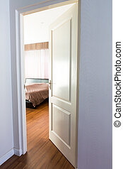 Door opening on a peaceful bedroom