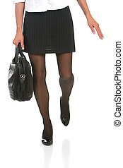 business woman with beautiful legs in a hurry. Shot against...