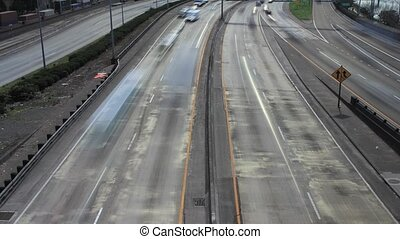 Timelapse of Moving Cars and Train on Highway in Portland...