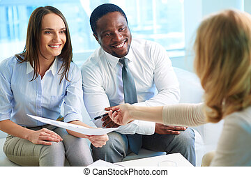 Financial adviser explaining how to improve the results of...