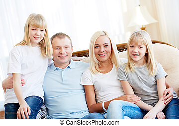 Happy family - Portrait of a happy family smiling cheerfully...