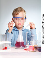 Reaction - Vertical shot of a school scientist being curious...