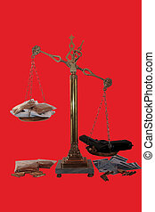 drug culture - an antique scales against a red background...
