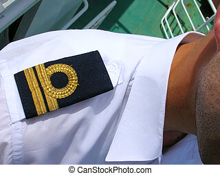 epaulet - black epaulet on shoulder with gold tracks closeup